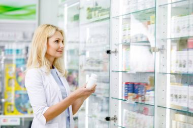 pharmacist holding container with medication
