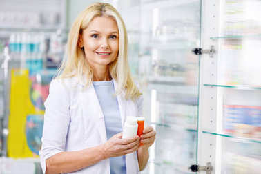 pharmacist holding containers with medications