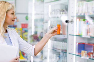 pharmacist with digital tablet and medication