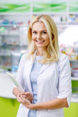 pharmacist with digital tablet in drugstore