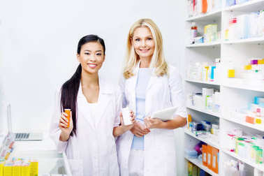 pharmacists with digital tablet and medication