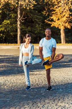 couple stretching on road