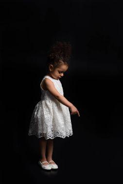 child showing at something