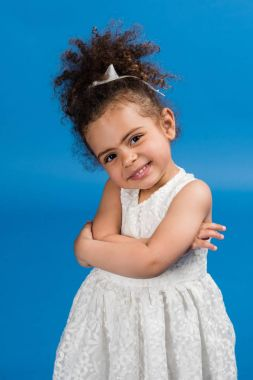 Smiling child standing in dress
