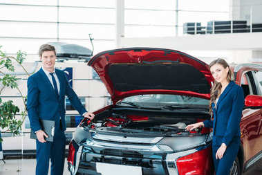 managers near car with open hood