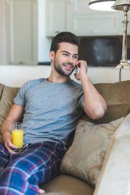 man talking on smartphone