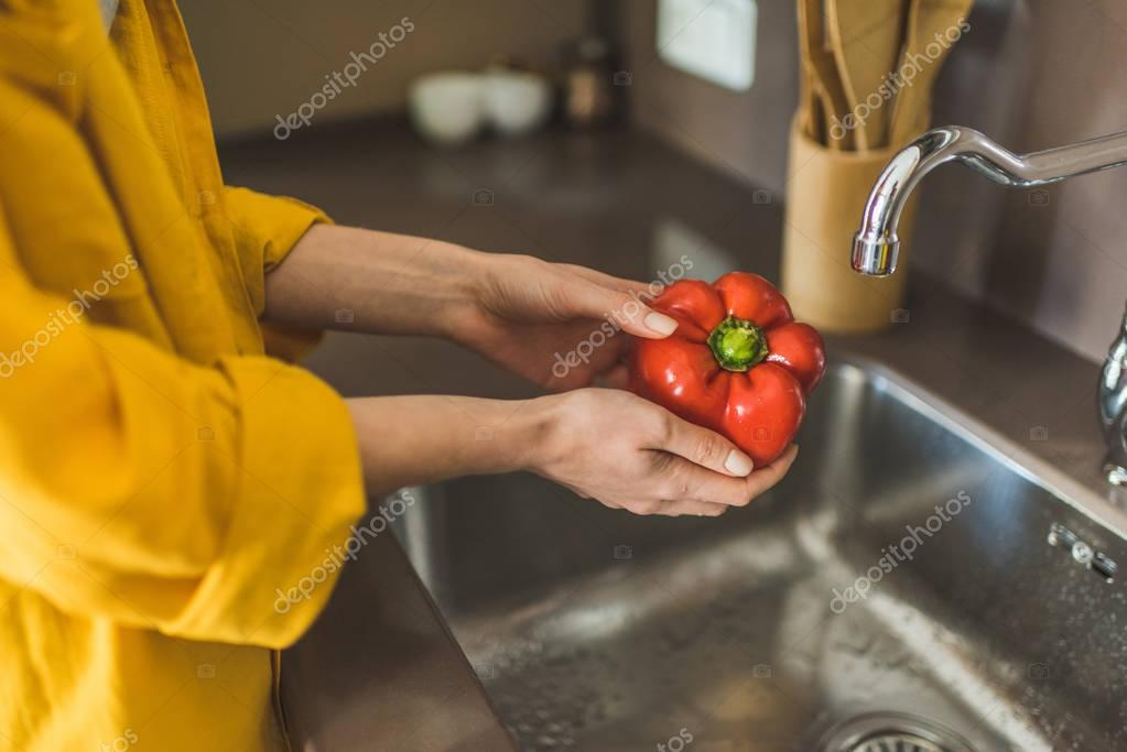 Woman Washing Red Pepper