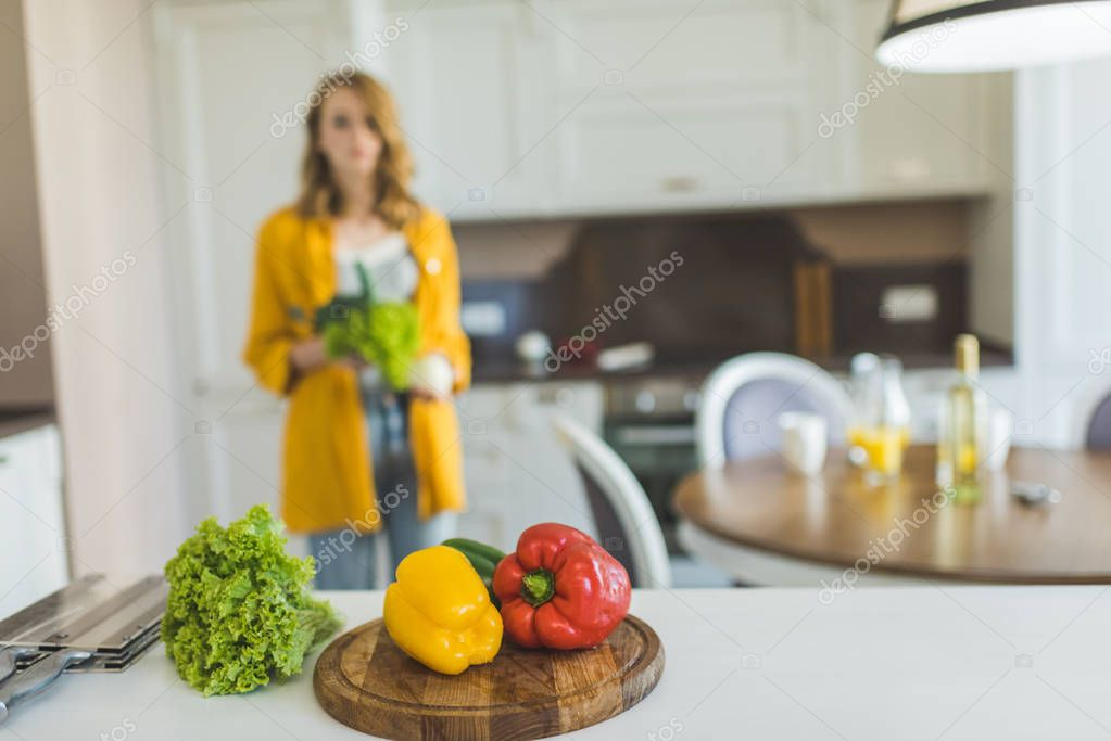 Woman with red and yellow peppers