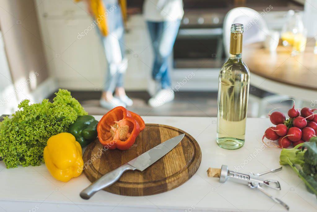 Fresh vegetables and bottle of wine