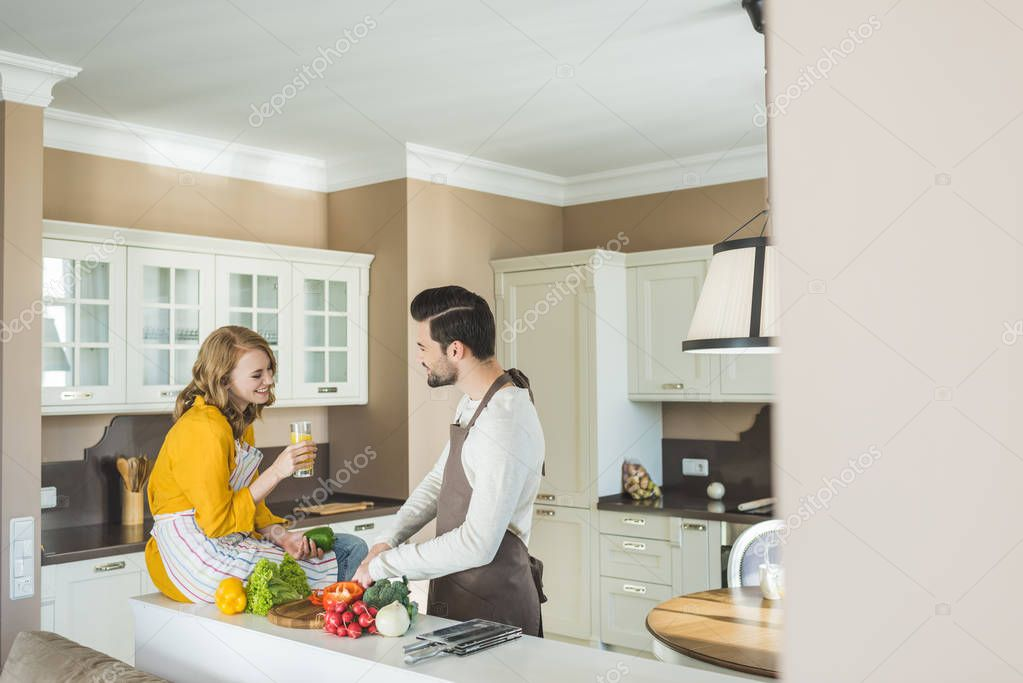 Couple preparing vegetables