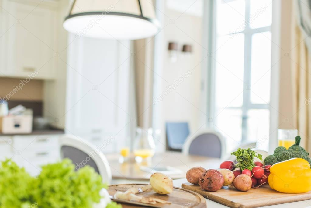 Vegetables and utensil on  table