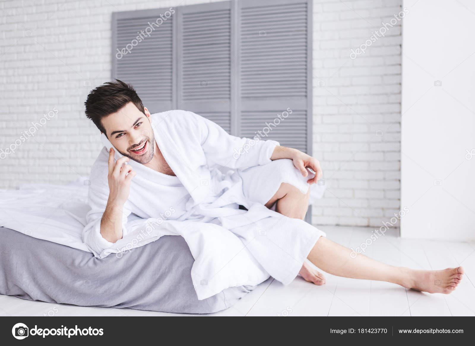 Handsome Young Man Bathrobe Talking Smartphone Looking Camera Free Stock Photo C Sashakhalabuzar 181423770