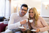 Fotografie smiling couple of travelers holding cups of coffee