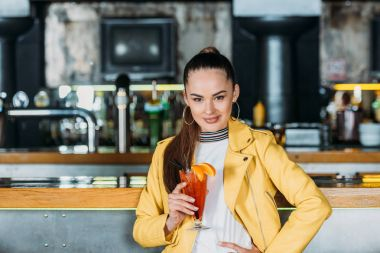 seductive young woman with cocktail spending time in bar