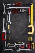 top view of set of various work tools on black