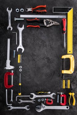 top view of set of various work tools on black