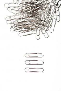 Close-up view of pile of paper clips on white stock vector