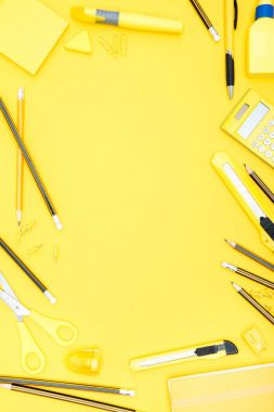 Flat lay of yellow office supplies, calculator and pencils with copy space on yellow stock vector