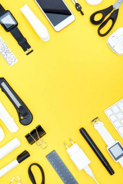 Flat lay of office supplies, digital devices with copy space on yellow stock vector