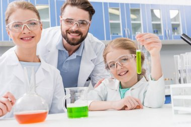 adult scientists and girl
