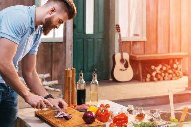 Man cutting onion