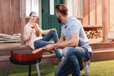 Young couple at barbecue