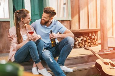 couple resting on porch