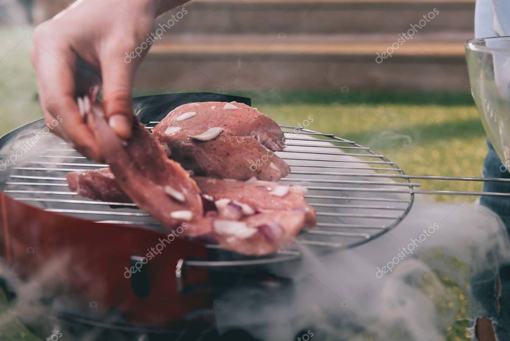 man roasting meat