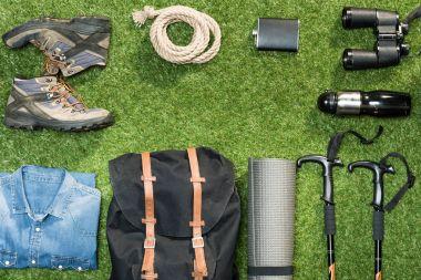 Traveler set on grassy background, flat lay stock vector