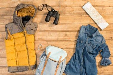 Traveler set on wooden background, flat lay stock vector
