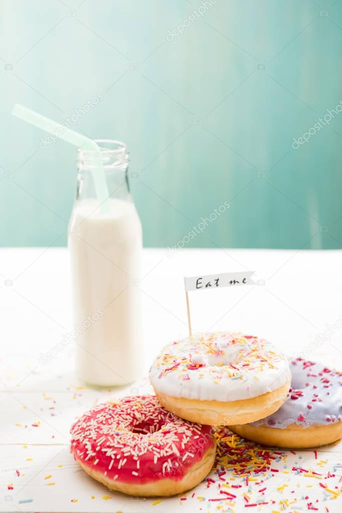 Donuts  with milkshake in bottle on the table