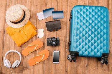 travel accessories on wooden floor