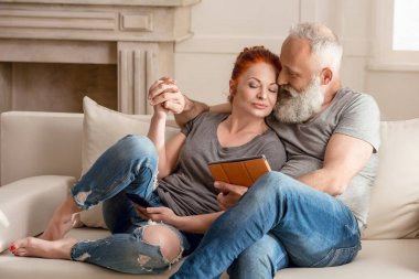 Mature couple with digital devices