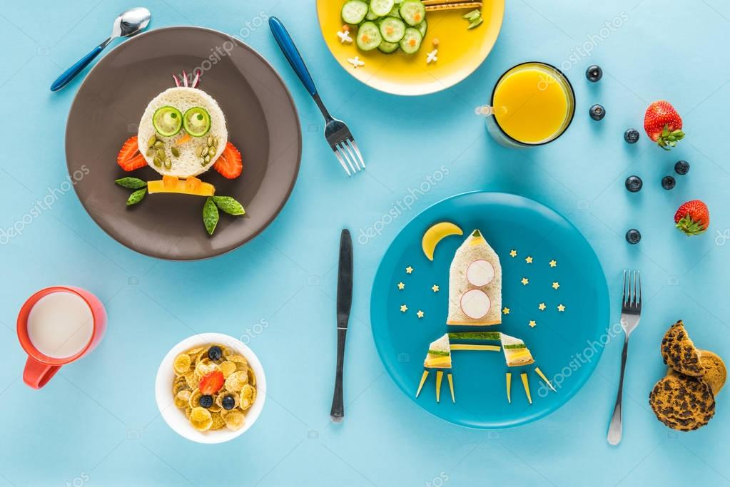 Flat lay with creatively styled children's breakfast on colorful tabletop stock vector