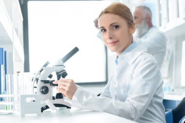 chemist working with microscope