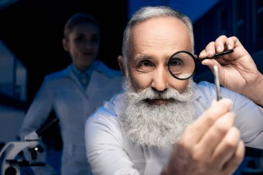 scientist with magnifying glass