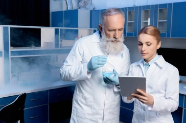 scientists in lab coats in laboratory