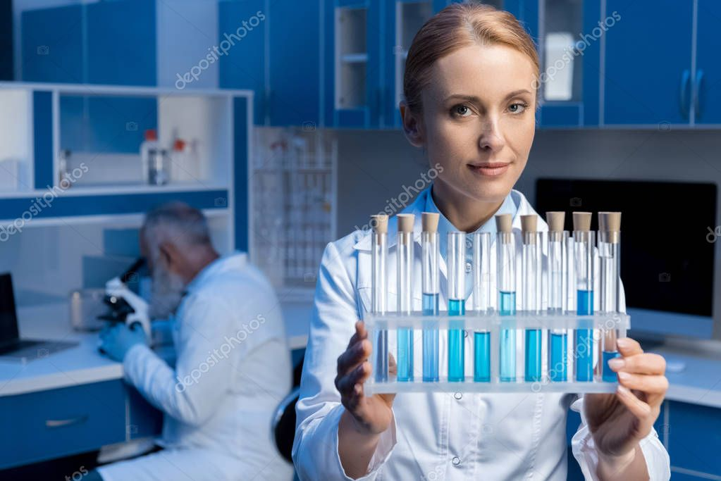 laboratory technician holding tubes