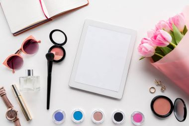 digital tablet, cosmetics and accessories