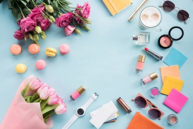 flowers with sunglasses and cosmetics with macaroons