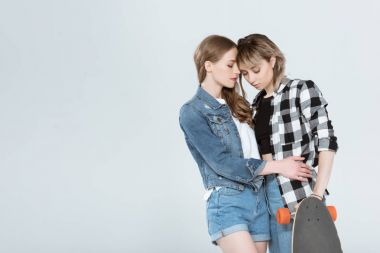 Lesbian couple with skateboard
