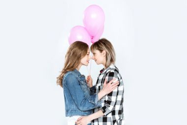 Lesbian couple with balloons