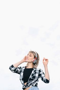 Girl listening music in headphones