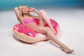 woman eating watermelon on float ring