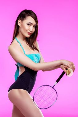 Girl in swimsuit with badminton racquet