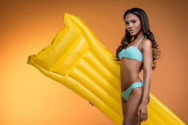 African american girl with swimming mattress