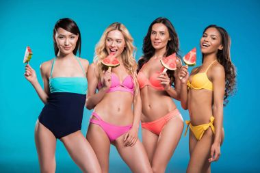multiethnic women holding watermelon slices
