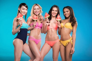 girls in swimsuitsposing with watermelon pieces