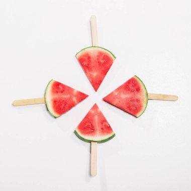 watermelon slices on popsicle sticks