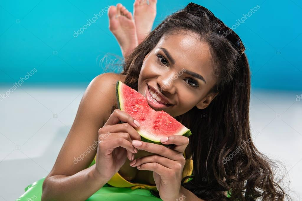 african american girl eating watermelon